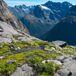 Glaciers in New Zealand's Fiordland once filled the valleys but have shrunk back to the mountain-tops since the last ice age ended 10,000 years ago.