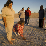 Aboriginal Elders inspecting the footprints - Photograph © Michael Amendolia